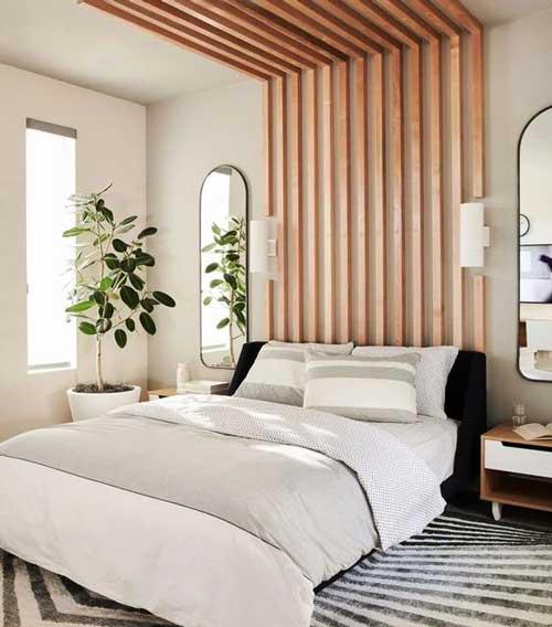 Sử dụng các thanh nan gỗ đơn giản ốp tường để tạo điểm nhấn cho phòng ngủ